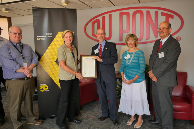 Chesterfield County Board of Supervisors Chairman Steve Elswick presents DuPont CEO Ellen Kullman a county resolution recognizing the 50th anniversary of Kevlar®. Joining Elswick and Kullman are Supervisor Dorothy Jaeckle, Marc Doyle, DuPont senior vice president, Safety and Protection, and Bill Dupler, deputy county administrator for community development. Photo courtesy of Chesterfield County Public Affairs.